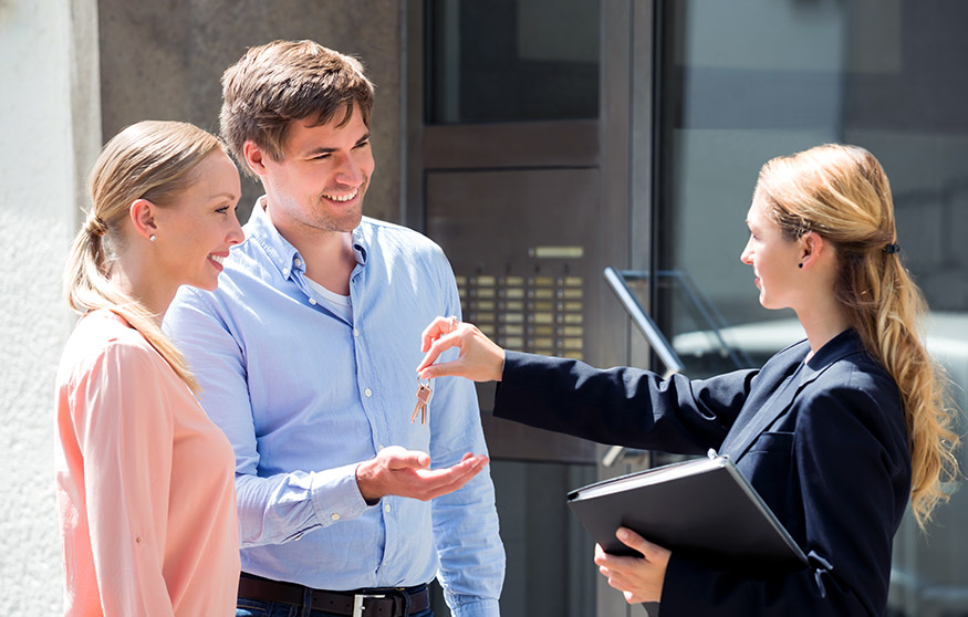 Handing over keys to tenants during a property handover