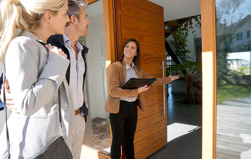Relocation agent showing tenants new property during a house relocation